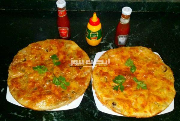 طريقة عمل فطيرة البيتزا في خطوتين للمبتدئين